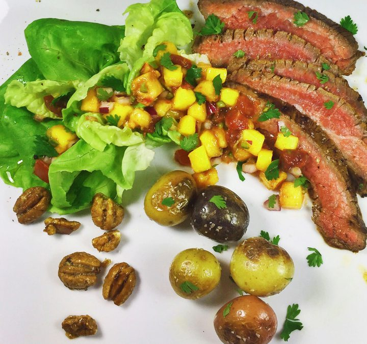 Grilled Flank Steak & Baby Potatoes with Mango Peach Salsa, Cherrywood Smoked Bibb Lettuce, and Candied Bourbon Pecans