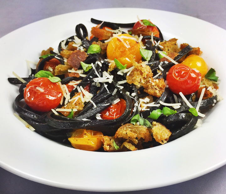Squid Ink Fettuccine with Pan-Seared Cherry Tomatoes, Parmesan, and Basil