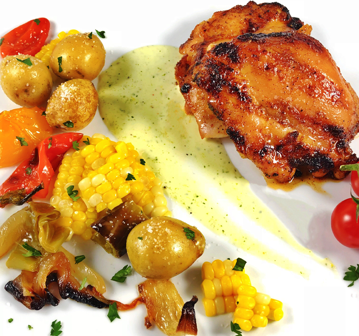 Grilled Spicy Chicken Thighs with Peppers and Onions, Lemon Cream Sauce, and Smoked Potatoes & Corn Salad