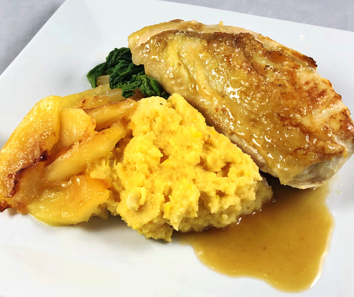 Pan Seared Chicken with Cider Lemon Sauce, Caramelized Apples, Cheddar Polenta with Fresh Corn, and Sautéed Mustard Greens