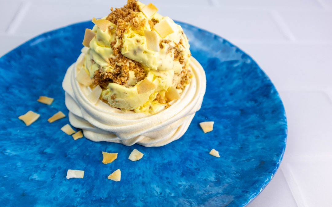 Mango and Passion Fruit Ice Creams with Coconut Clusters in Banana Meringue Shells